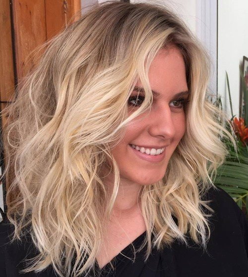 17 popular medium length hairstyles for thick hair best hairstyle 1wavy medium length hairstyle winobraniefo Choice Image